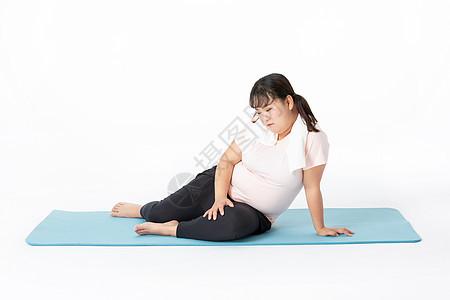 胖女生运动休息图片