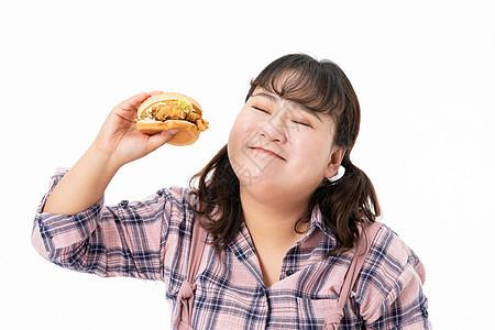 胖女孩开心吃汉堡图片
