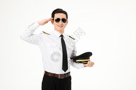 飞行员拿着帽子敬礼图片