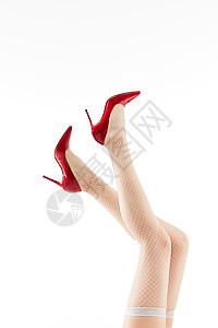 女性展示白色丝袜与红色高跟鞋图片