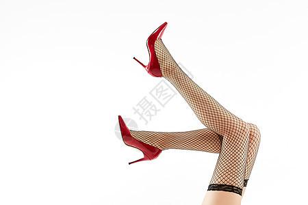 女性穿着黑色丝袜和黑色高跟鞋特写图片