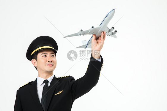 飞行员机长手拿飞机形象图片