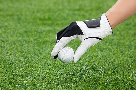 手拿高尔夫球图片