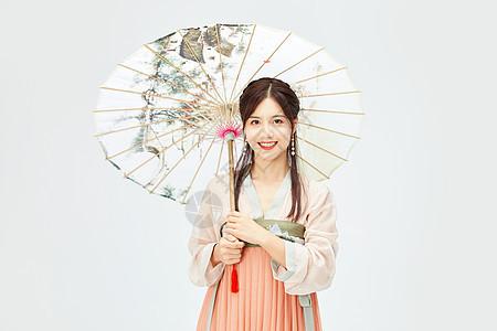 古风汉服美女手拿雨伞图片