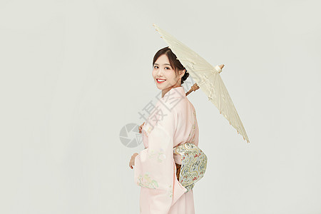 和服女孩撑油纸伞回眸图片