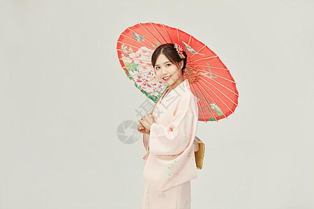和服美女手撑油纸伞图片