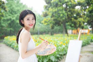 文艺女性户外绘画图片