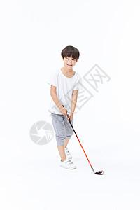 小男孩打高尔夫球图片