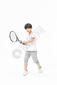 小男孩打网球图片