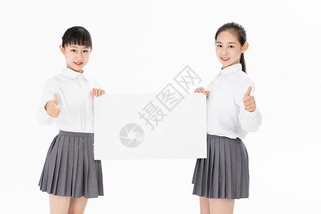 中学生手拿白板图片