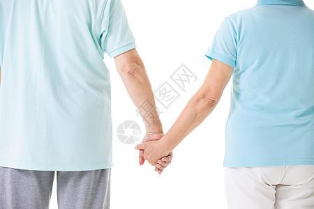 老年夫妇牵手背影图片