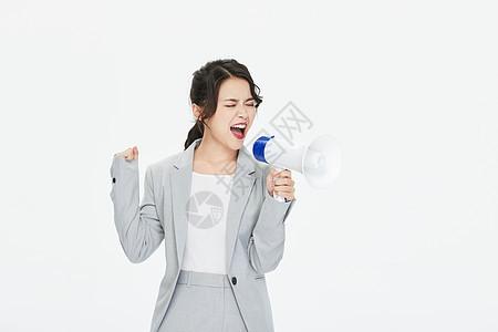 商务女性拿喇叭喊话图片