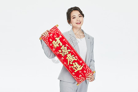 商务美女拿春联迎新年图片