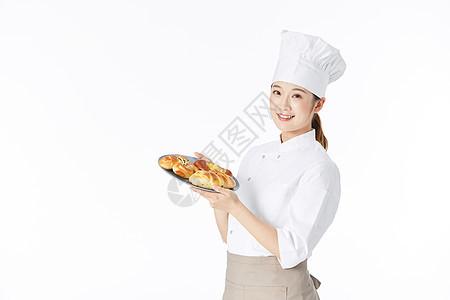 女面点师手捧面包图片