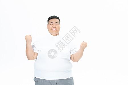 青年男性胖子加油手势图片
