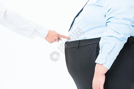 肥胖商务男性指肚子图片
