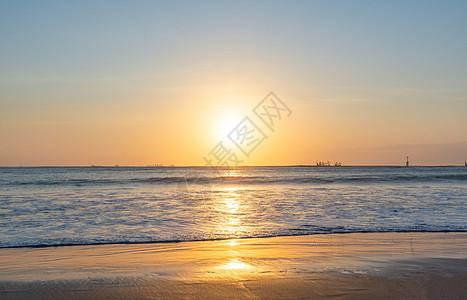巴厘岛金巴兰海滩的日落美景图片