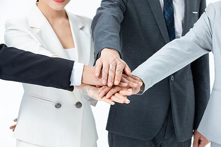 商务团队搭手合作图片