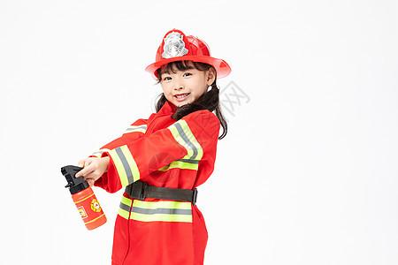 小小消防员拿着消防器图片