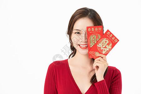 女性拿红包图片