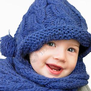 戴帽子和围巾微笑的女孩图片