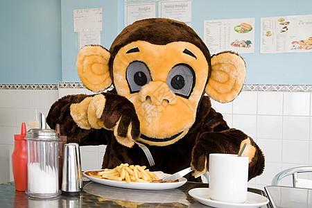 在咖啡馆穿猴子服装的人图片