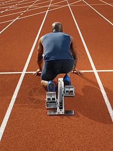 在起跑线的男子短跑运动员图片
