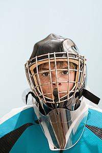 穿冰球服的男孩图片