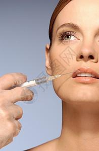 唇部注射的妇女图片