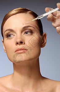 脸部注射的妇女图片