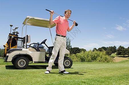 手持高尔夫球杆的高尔夫球手图片