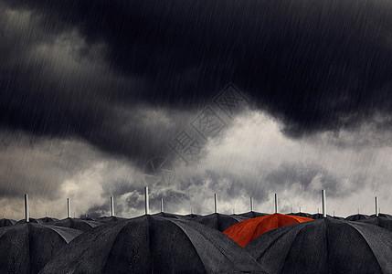 黑色伞堆中的红色伞图片