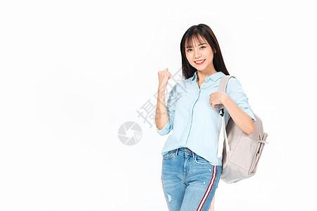 成人教育美女大学生背书包开心庆祝图片