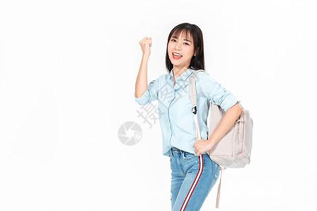 成人教育美女大学生背书包图片