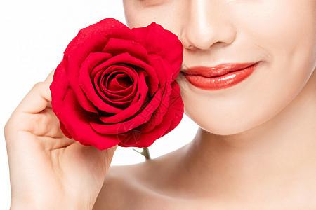 美女拿玫瑰花局部特写图片
