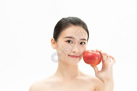 美妆少女与苹果图片