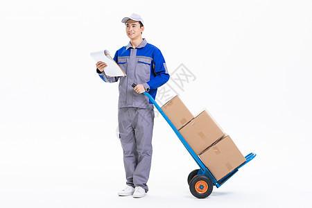 推手推车运送货物的搬运工人图片