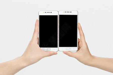 手持智能手机特写图片