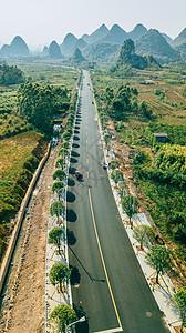 航拍风光公路美丽风景笔直蜿蜒的山景公路图片