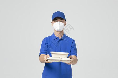 防疫外卖小哥戴口罩送餐图片
