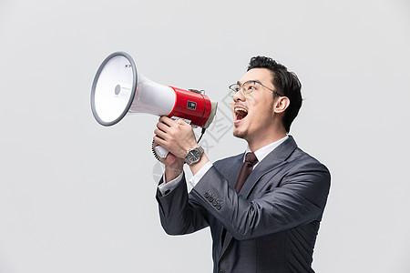 商务男性拿大喇叭喊话图片