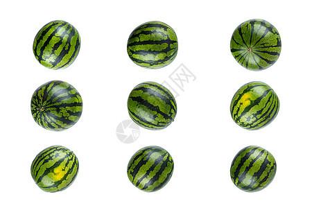 白色背景拍摄多个绿色西瓜图片