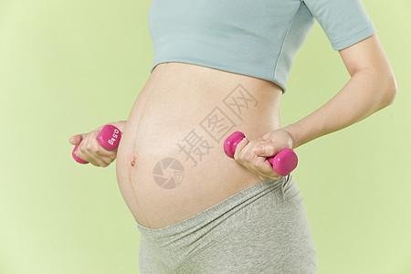 孕妇用哑铃健身图片