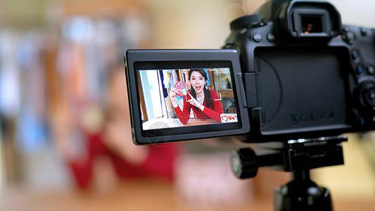 网络直播销售带货卖商品相机特写图片