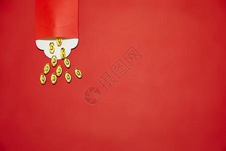 新年静物红包里的金元宝图片