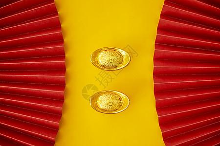 金色背景新年静物元宝图片