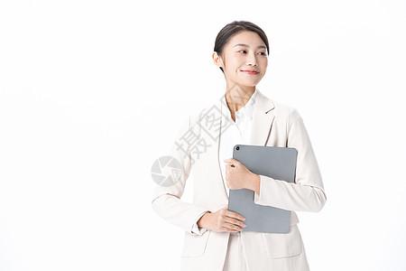 女性商务白领办公拿文件夹图片